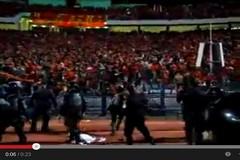 اشتباكات بين مشجعي الأهلي والشرطة